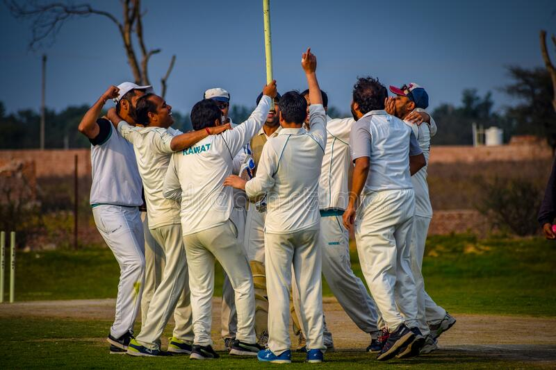 Gurgaon India – March 3 2019 : Full length of cricketer playing on field during sunny day. Gurgaon India – March 3 2019 : Full length of cricketer royalty free stock photography