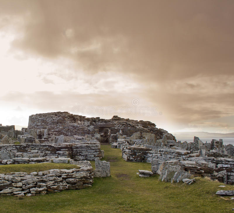Gurness Broch under stormy sky royalty free stock photography