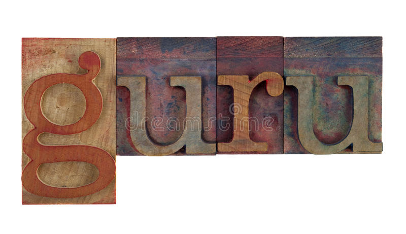 Guru. The word guru in vintage wooden letterpress type blocks, stained by color ink, isolated on white stock photography
