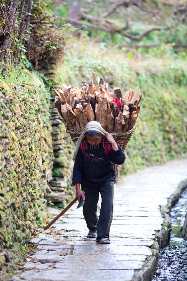 Gurung peasant with basket stock photography