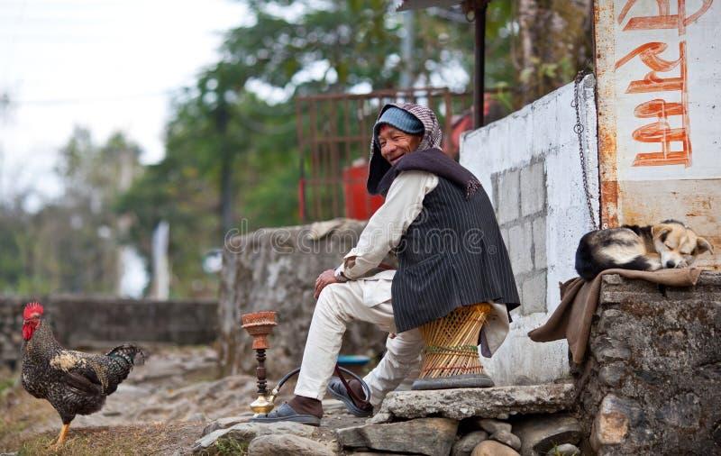 Gurung peasant and his pets stock photos