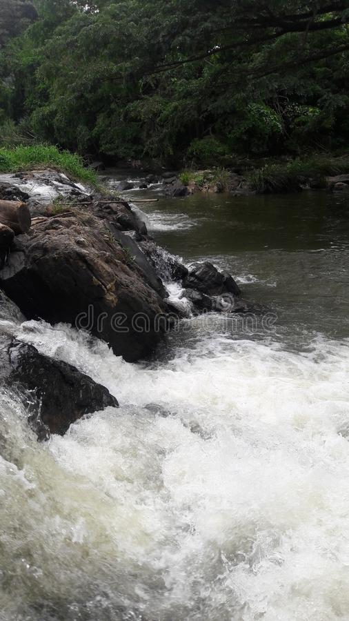 Gush of water.flows down.nature .beautiful .touches against rocks. Gush of water.flows down.nature .beautiful .touches against. Gush, waterflows, downnature royalty free stock image