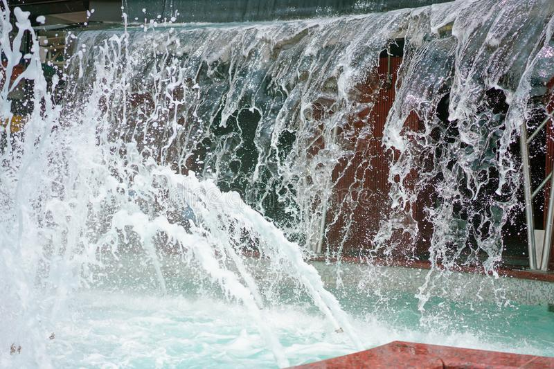 The gush of water of a fountain. Splash of water in the fountain, abstract image royalty free stock photo