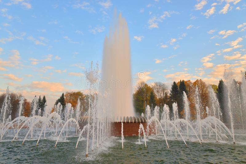 The gush of water of a fountain. The gush of water of a fountain in St. Petersburg at sunset, Russia stock images