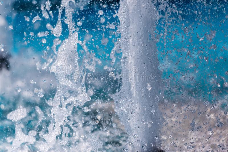 The gush of water of a fountain. Splash of water in the fountain. Abstract image royalty free stock photography