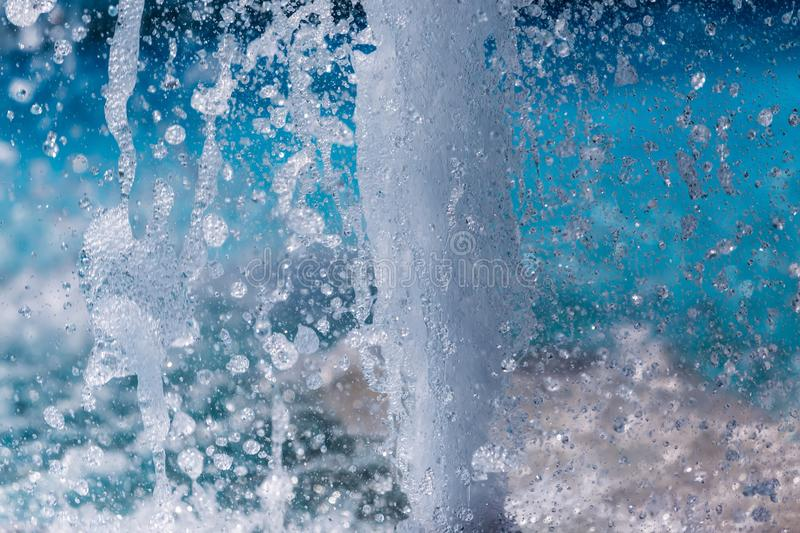 The gush of water of a fountain. Splash of water in the fountain. Abstract image stock images