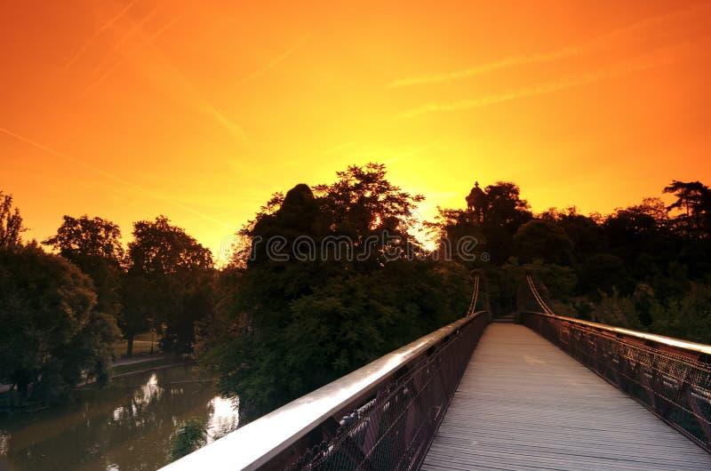 Gustave Eiffel bridge in the Parc des Buttes-Chaumont. The Parc des Buttes-Chaumont in Paris stock images