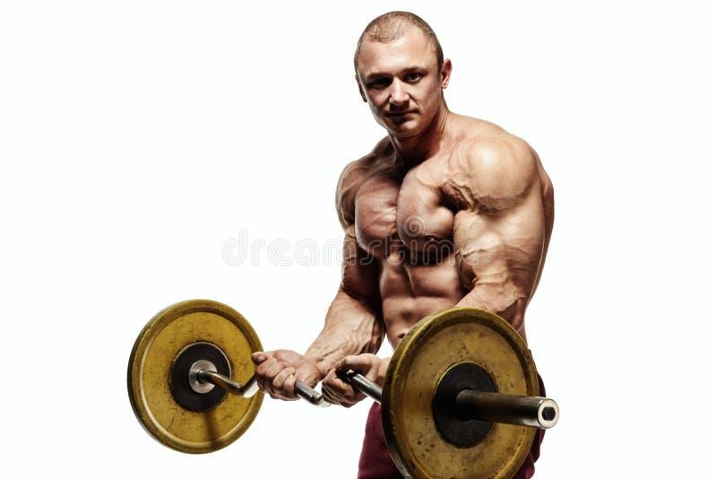 Gut aussehender Mann mit den großen Muskeln lizenzfreie stockfotografie