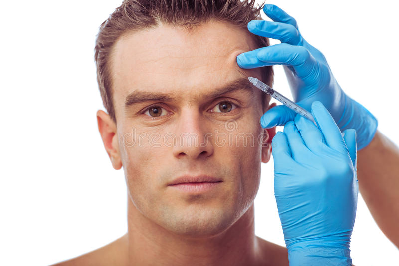 Gut aussehender Mann und plastische Chirurgie stockfotos