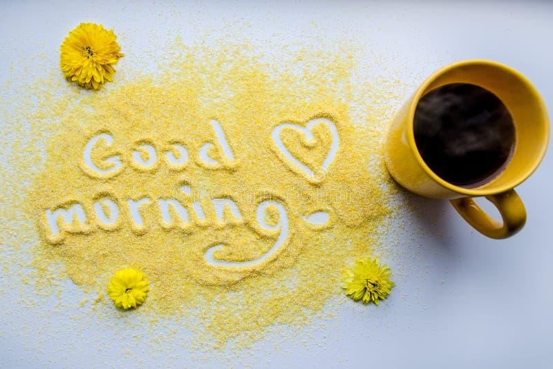 Gutenmorgen mit einem Tasse Kaffee lizenzfreies stockbild