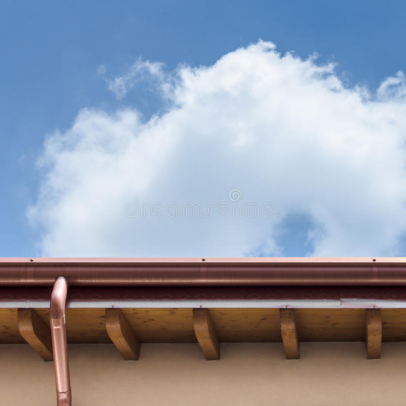 Gutter. Plumbing consist of copper gutter and drain royalty free stock images