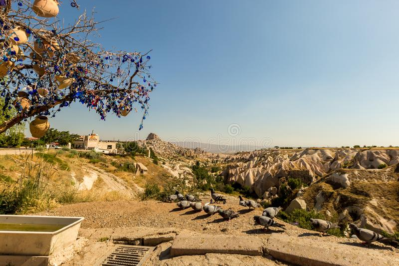 Guvercinlik Valley and Fairy tale chimneys in Turkey. Guvercinlik Valley and Fairy tale chimneys on background of blue sky in Goreme, Cappadocia, Turkey royalty free stock photo