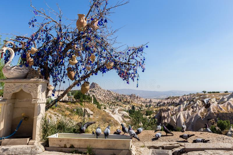 Guvercinlik Valley and Fairy tale chimneys in Turkey. Guvercinlik Valley and Fairy tale chimneys on background of blue sky in Goreme, Cappadocia, Turkey royalty free stock image