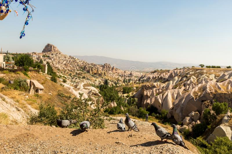 Guvercinlik Valley and Fairy tale chimneys in Turkey. Guvercinlik Valley and Fairy tale chimneys on background of blue sky in Goreme, Cappadocia, Turkey stock photos