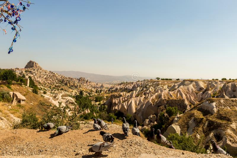 Guvercinlik Valley and Fairy tale chimneys in Turkey. Guvercinlik Valley and Fairy tale chimneys on background of blue sky in Goreme, Cappadocia, Turkey royalty free stock photography