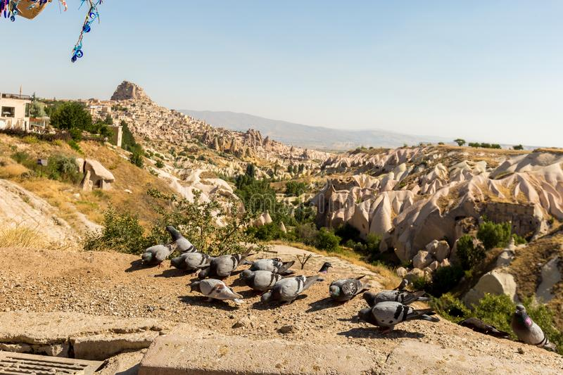 Guvercinlik Valley and Fairy tale chimneys in Turkey. Guvercinlik Valley and Fairy tale chimneys on background of blue sky in Goreme, Cappadocia, Turkey royalty free stock photos