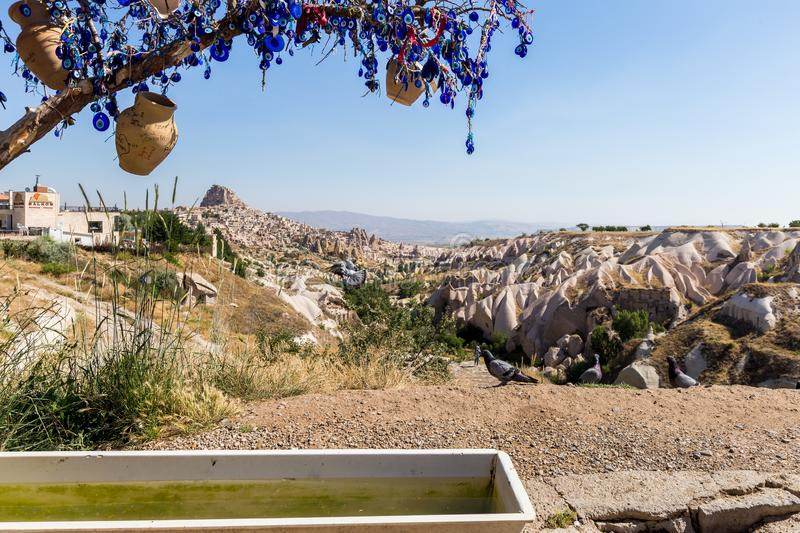 Guvercinlik Valley and Fairy tale chimneys in Turkey. Guvercinlik Valley and Fairy tale chimneys on background of blue sky in Goreme, Cappadocia, Turkey royalty free stock images