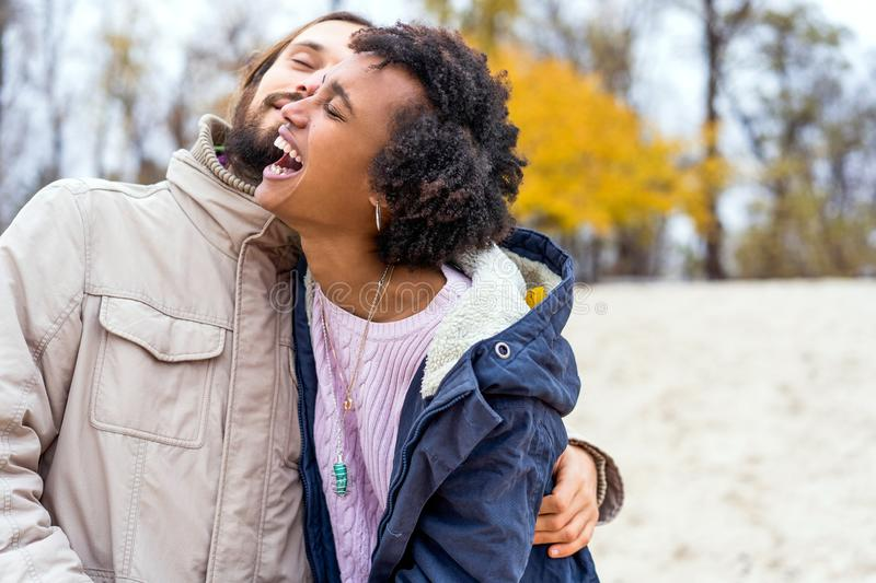 Guy with an african american girl in love in autumn park makes her an offer to get married royalty free stock images