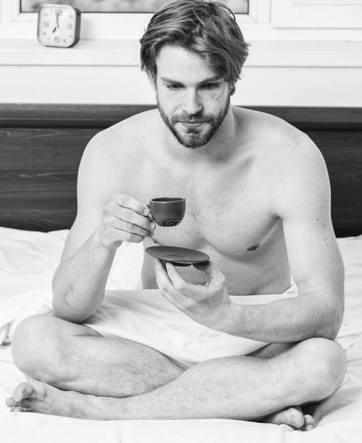Guy attractive appearance man enjoy hot fresh brewed coffee. First thing in morning. Every morning with his coffee. Man stock photo