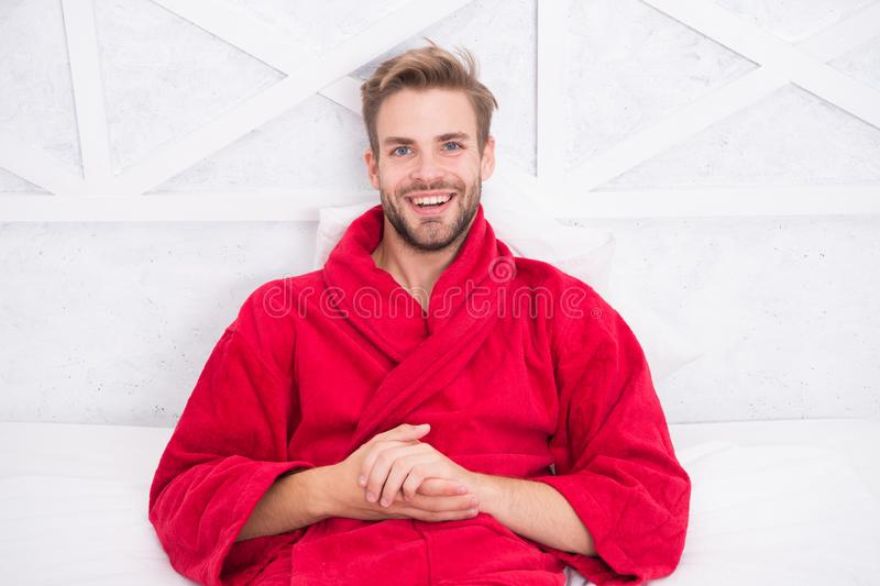 Guy in bathrobe relaxing. Relaxing before fall asleep. Get enough amount of sleep every night. Maintaining consistent. Circadian rhythm essential for general royalty free stock photos