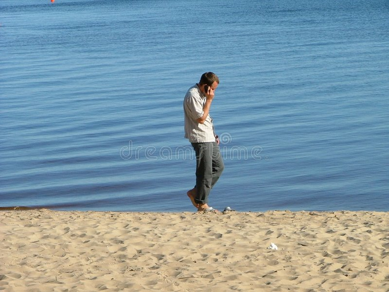 Download Guy on the beach stock image. Image of river, pants, phone - 124821