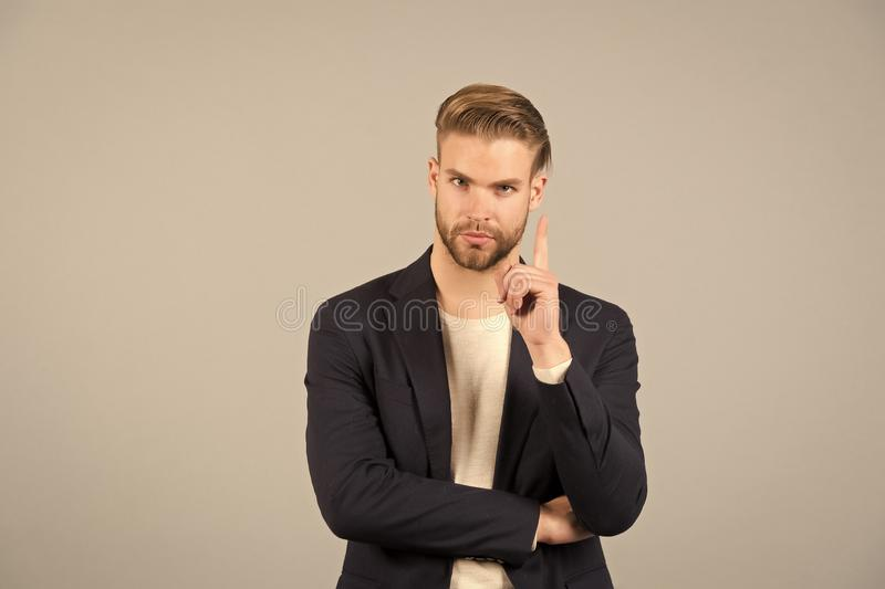 Guy bearded attractive shows warning gesture. Attention concept. Man with beard unshaven guy looks handsome well groomed. Formal wear. Businessman bearded royalty free stock photos