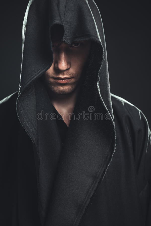Guy in a black robe royalty free stock photos