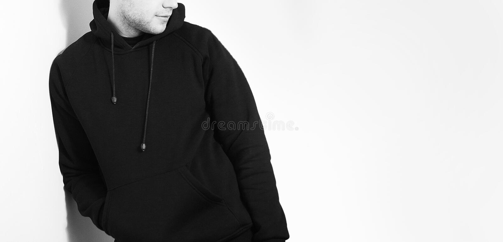 The guy in the Blank black hoodie, sweatshirt, stand, smiling on stock photo