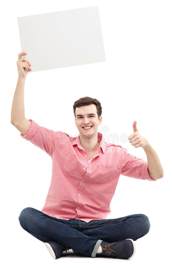 Guy with blank sign showing thumbs up royalty free stock photography