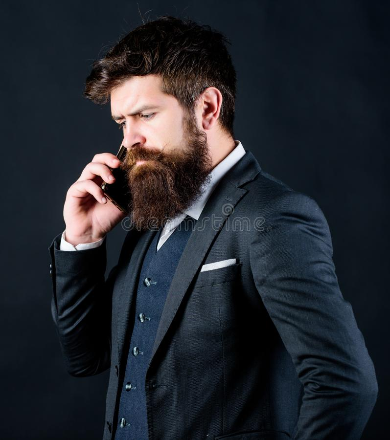 Guy call friend stand black background. Mobile call concept. Man formal suit call someone. Mobile call conversation royalty free stock image