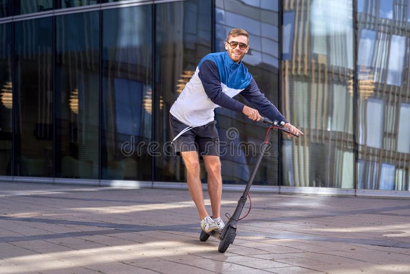 Guy cares about environment and travels on scooter royalty free stock photos