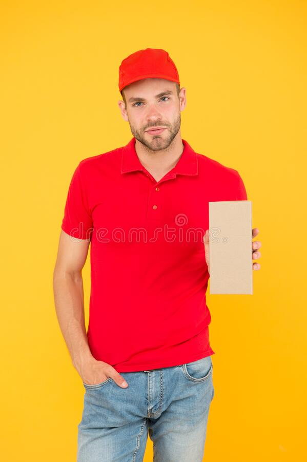 Guy cashier uniform. cafe staff wanted. man delivery service in red tshirt and cap. friendly shop assistant. food order royalty free stock photography