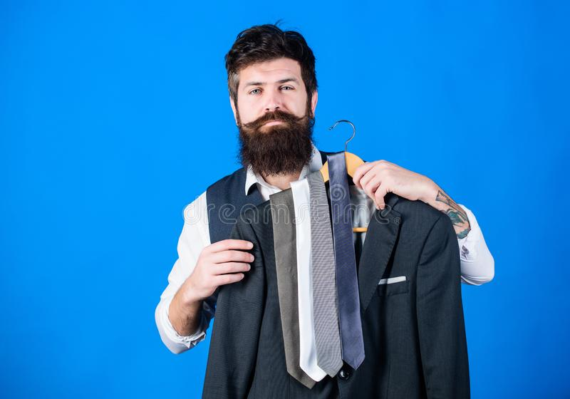 Guy choosing necktie. Perfect necktie. Shopping concept. Shop assistant or personal stylist service. Stylist advice royalty free stock photo