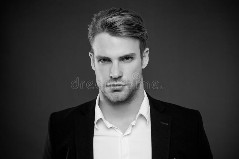 Guy confident in his appearance. Confidence and masculinity. Man well groomed with bristle and hairstyle grey background. Macho confident strict face close up royalty free stock image