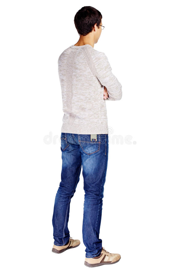 Guy with crossed arms. Full length half turn back view portrait of young man in glasses and beige sweater with crossed arms on his chest isolated on white royalty free stock photo