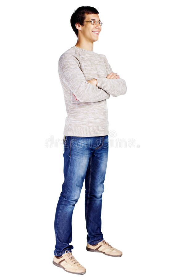 Guy with crossed arms. Full length half turn view portrait of smiling young man in glasses and beige sweater with crossed arms on his chest isolated on white royalty free stock photos