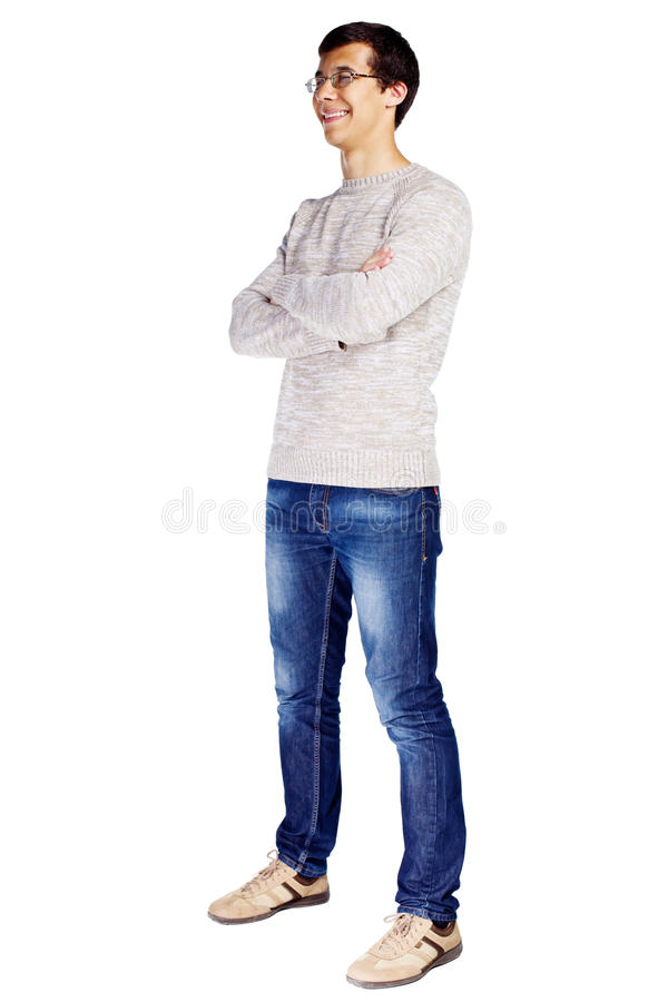 Guy with crossed arms. Full length half turn view portrait of smiling young man in glasses and beige sweater with crossed arms on his chest isolated on white royalty free stock photo