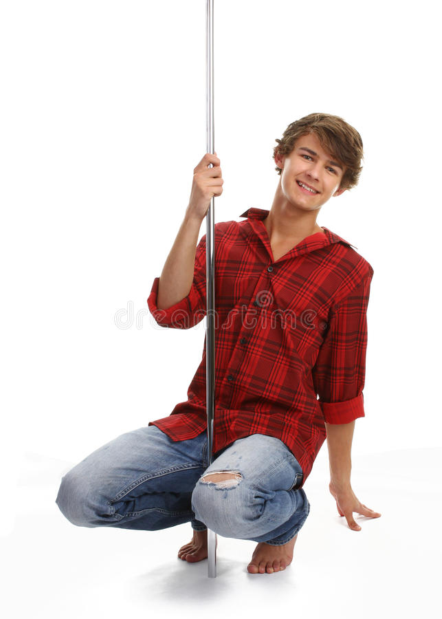 Guy crouching dancing. Guy crouching on a dance pole royalty free stock photos
