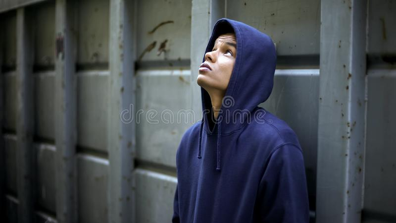 Guy in depression has no support, adolescent crisis, transition age troubles. Stock photo royalty free stock photography