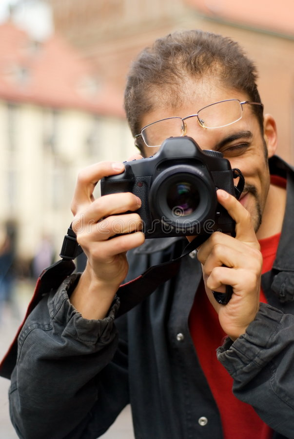 Guy with a digital camera stock image