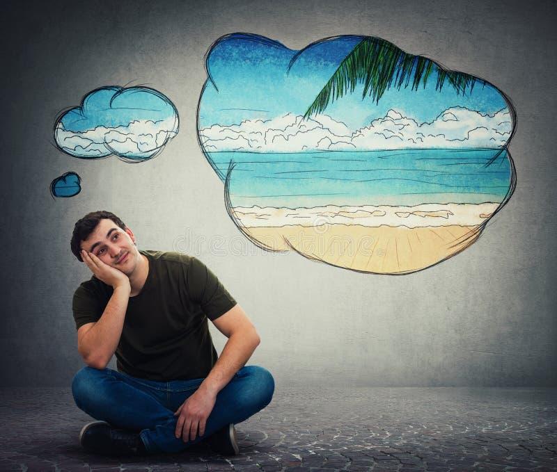 Guy dreamer imagining a exotic seaside beach adventure stock photo
