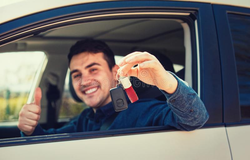 Guy driver showing thumb up positive gesture and smiling stock photography