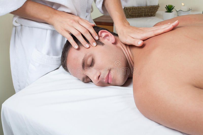 Guy enjoying a massage royalty free stock image
