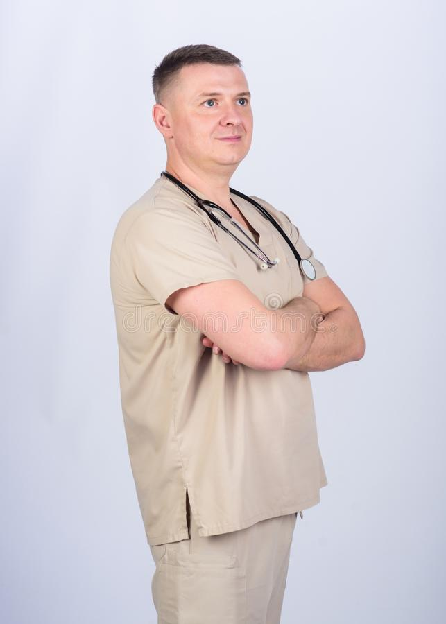 Guy experienced doctor beige clothes on white background. Private clinic. Check health. Doctor career. Man doctor. Stethoscope physician uniform. Medicine and stock photography