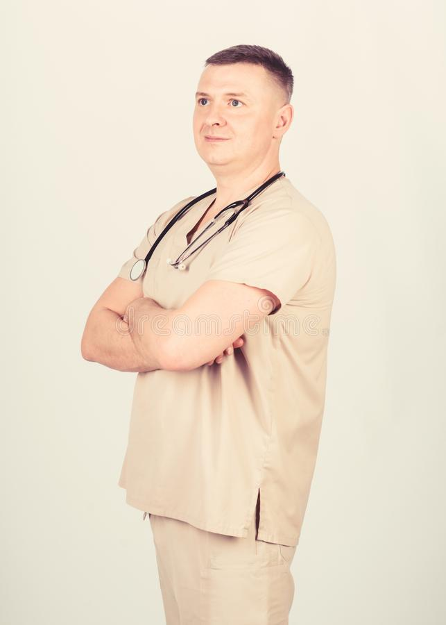 Guy experienced doctor beige clothes on white background. Private clinic. Check health. Doctor career. Man doctor. Stethoscope physician uniform. Medicine and stock images