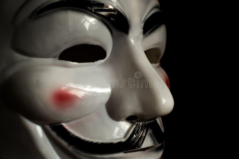 Guy Fawkes Mask em um fundo de madeira fotografia de stock royalty free