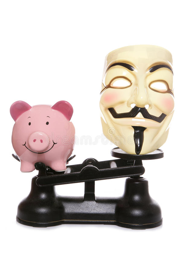 Guy Fawkes Mask With Piggy Bank Editorial Photography