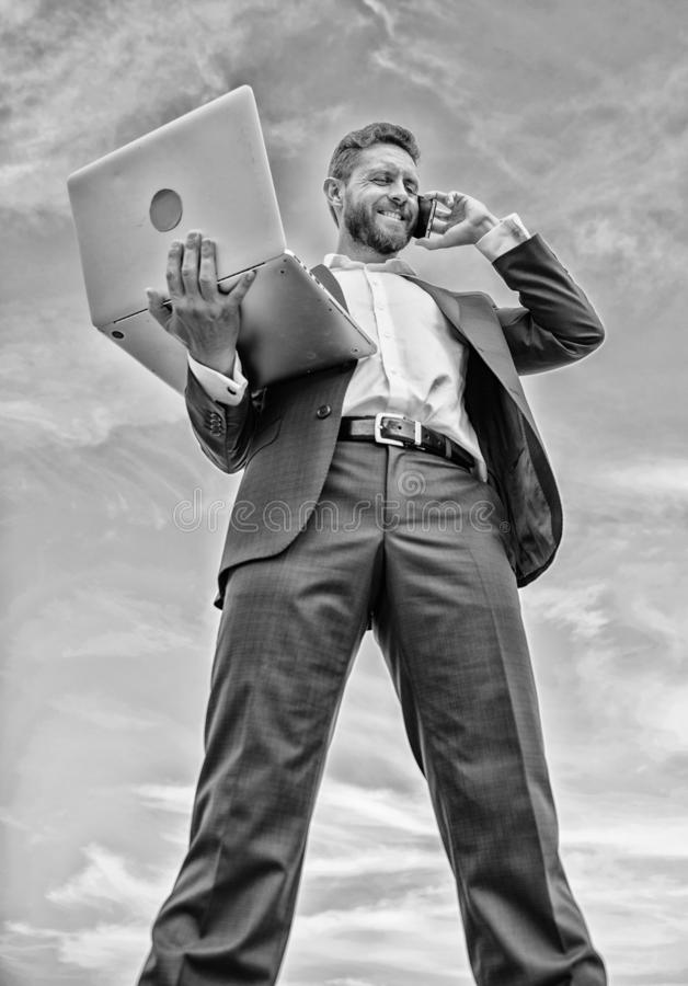 Guy formal suit modern technology manager entrepreneur answer phone call. Man well groomed businessman holds laptop stock photo