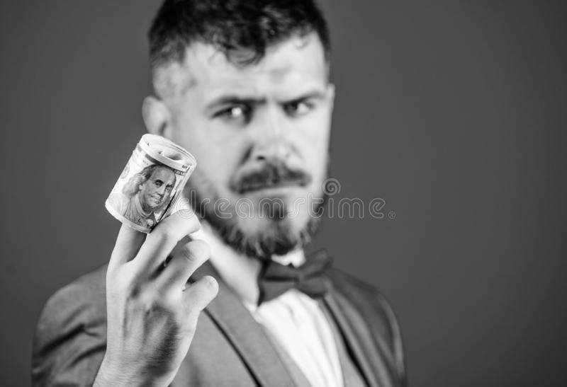 Guy formal suit offer bribe or purchase. Hipster offer money blue background close up. Easy money concept. Rich. Businessman hold rolled money. Man bearded stock photos