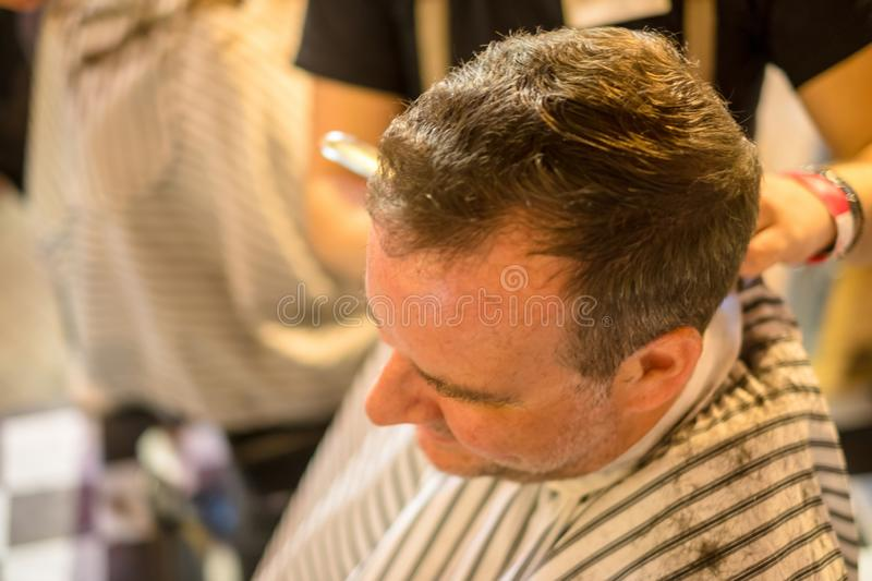 Guy at the hairdresser stock photos
